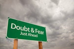bigstock_Doubt_And_Fear_Green_Road_Sign_8148633