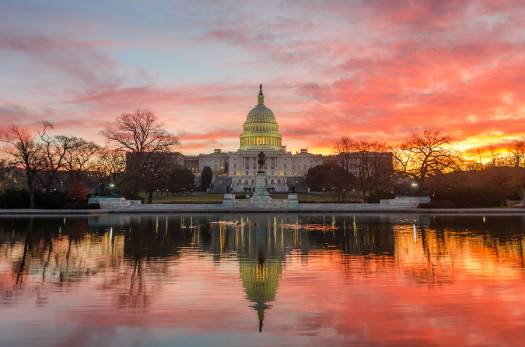 Washington DC, Capitol Building in a cloudy sunrise with mirror