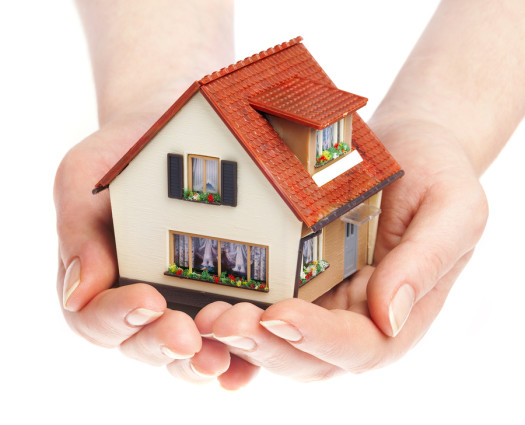 bigstock-The-house-in-human-hands-17016914